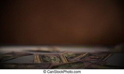 Falling dollars isolated on dark black background Slow Motion 400 fps