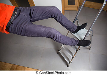 Man is falling down from ladder at home
