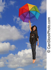 Happy Woman Falling From the Sky Holding Colorful Umbrella