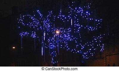 Falling drops of holiday illumination close-up