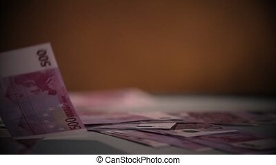Falling Euro banknotes isolated on black dark background in slow motion 400 fps