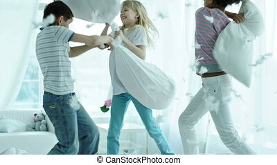 Falling feathers - Kids pillow fighting so hard that...