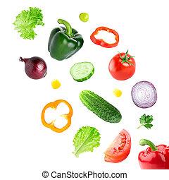 Falling fresh vegetables