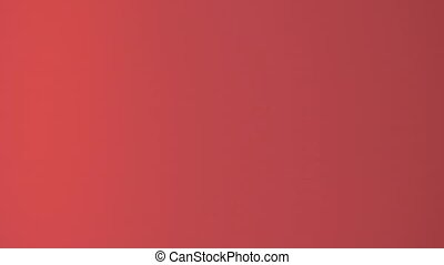Falling golden stars in slow motion at red background
