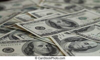 Falling hundred dollar bills close up