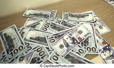 Falling hundred dollars banknotes close up