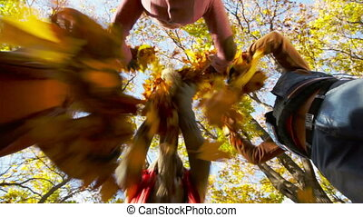 Falling Leaves - Ecstatic friends throwing armfuls of leaves...