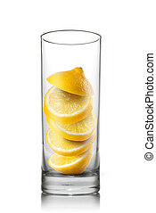falling lemon slices inside glass isolated