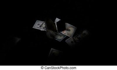 Falling one hundred dollars pile as black background.