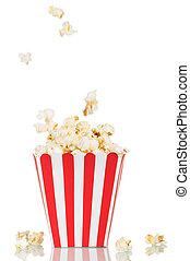 Falling popcorn in large square box and beside her, on...