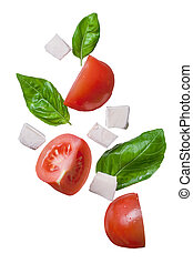 falling red tomatoes, mozzarella and basil isolated on white...