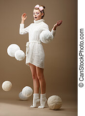 Falling Skeins. Surprised Woman in Woolen Knitted Jersey...