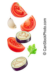 Falling slices of tomato and eggplant