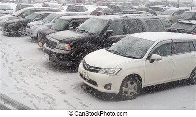 Falling snow in Car park at Japan - Falling snow in Car park