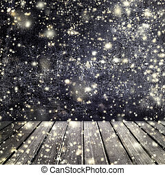 Falling snow on a black background with empty wood table for...