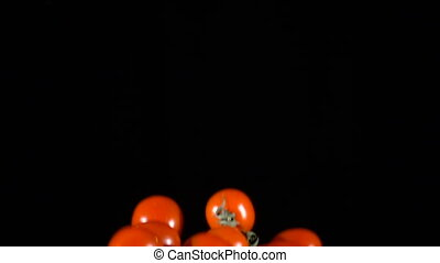 Falling tomatoes cherry, slow motion