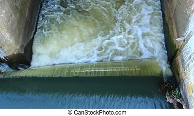 falling water on the small dam - falling water and rustling...
