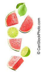 Falling watermelon and lime isolated on white