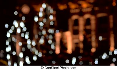 Falling white lights in the city background. Atmosphere...