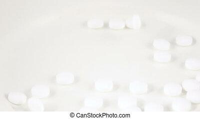 Falling white pills