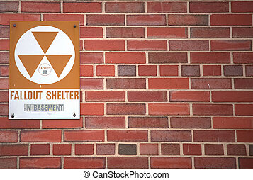 A sign indicating the whereabouts of a fallout shelter.