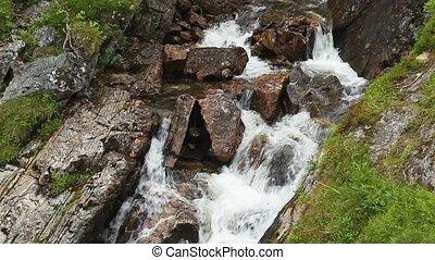 Falls in mountains of Norway. Voringsfossen Waterfall....