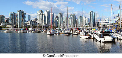 A panorama of False Creek marina and the south Vancouver BC skyline, Canada.