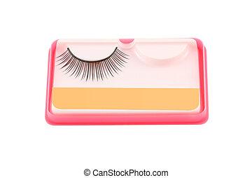 False eyelashe in pink package on white background.