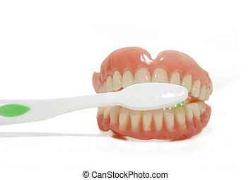 false teeth and toothbrush - False teeth prosthetic with...
