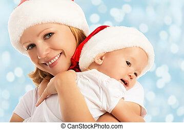 família feliz, mãe bebê, em, chapéus natal