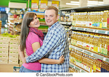 família, jovem, supermercado
