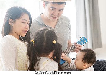 família, tocando, ukulele