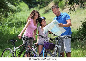 família, uma bicicleta, passeio
