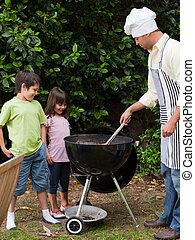 famiglia, avendo barbecue, giardino