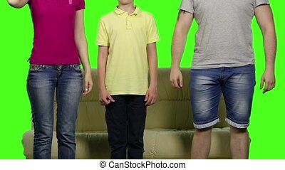 Famile using virtual reality glasses sitting on the sofa. Green screen. Slow motion