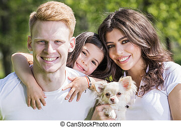 familia feliz, con, un, perro