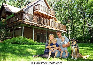 familia feliz, en, cabaña, en, el, bosque