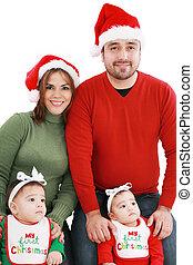 familia feliz, en, navidad, trajes
