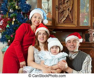 familia feliz, en, sombreros de navidad
