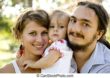 familia feliz, en, verano, parque
