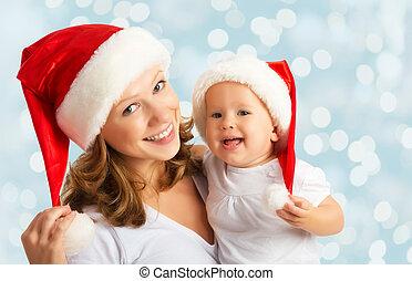 familia feliz, madre y bebé, en, sombreros de navidad