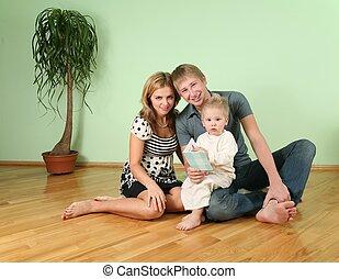 familia , sentarse, en, el, habitación, en, piso, 2