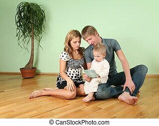 familia , sentarse, en, el, habitación, en, piso