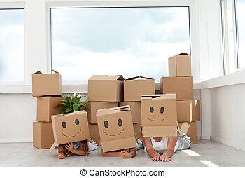 familia , tener diversión, con, cajas de cartón