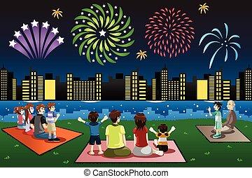 familias, mirar, fuegos artificiales, en, un, parque