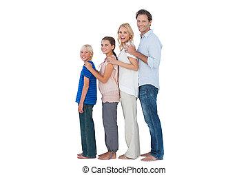 familie, aufwirft, zusammen, und, anschauen kamera