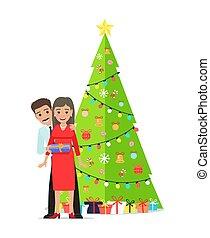familie, paar, baum, girlanden, dekoriert, weihnachten
