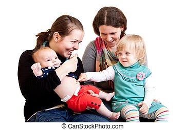 Families - Two young mothers with their daughters. Isolated...