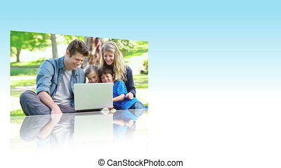 Families using laptops in a park