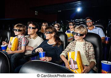 Families Watching 3D Movie In Theater